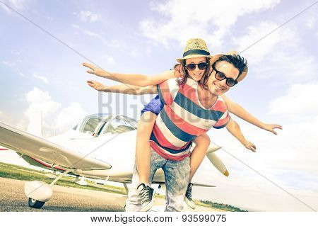 Happy Hipster Couple In Love On Airplane Travel Honeymoon Vacation - Summer Fun Concept