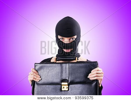 Industrial espionage concept with person in balaclava