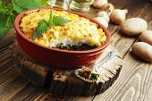 pic of nettle  - Potato casserole with meat and nettle on the table - JPG
