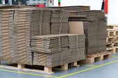 picture of assembly line  - Large number of folded cardboard boxes are made up in a designated place in the assembly hall - JPG