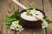 picture of jasmine  - Plate with jasmine rice and jasmine flowers on a wooden background - JPG