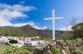 stock photo of cross hill  - Summer mountain view with white wooden cross - JPG