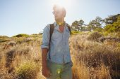 picture of walking away  - Image of young man walking on mountain trail looking away - JPG