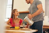 pic of breakfast  - Shot of young couple having breakfast in kitchen - JPG