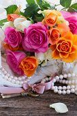 picture of mother-of-pearl  - pink and orange roses with key  and pearls - JPG