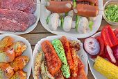 picture of grilled sausage  - Table With Different Cookout Food For Summer BBQ Grill Family Party - JPG