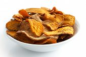 stock photo of parsnips  - Bowl of fried carrot and parsnip chips - JPG