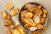 picture of parsnips  - Fried carrot and parsnip chips in rustic wood bowl - JPG
