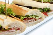 stock photo of baguette  - Platter of ham and salad baguettes on white - JPG