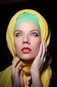 pic of burqa  - Serious woman wearing colourful headscarf - JPG