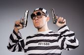 picture of prison uniform  - Funny prisoner with weapon isolated on gray - JPG