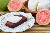 pic of juliet  - Brazilian dessert Romeo and Juliet on white plate goiabada and Minas cheese with fresh goiaba on bamboo - JPG