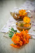 picture of marigold  - Herbal tea with marigold flowers on the table - JPG