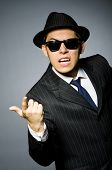 picture of gangsta  - Young man in classic striped costume and hat isolated on gray - JPG