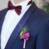 foto of boutonniere  - groom boutonniere buttonhole lapel groomsman flower wedding - JPG