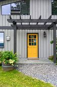 picture of house woods  - Entrance of a luxury mid-century modern cottage house with yellow door