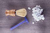 pic of razor  - Foam razor and brush over dark wooden table horizontal image - JPG