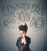 stock photo of hysterics  - Mad young woman with extreme haisrtyle and speech bubbles concept on background - JPG
