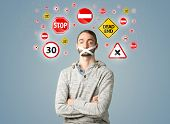 foto of traffic signal  - Young man with taped mouth and traffic signals around his head   - JPG