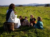 picture of jesus  - Jesus Christ teaching a group of young children in an open field - JPG