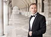 picture of tuxedo  - Portrait of a handsome young man in elegant tuxedo  - JPG