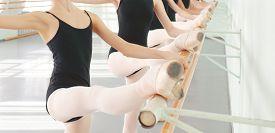 image of ballerina  - legs of young dancers ballerinas in class classical dance ballet - JPG