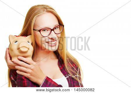 Young blonde happy woman holding her piggy bank