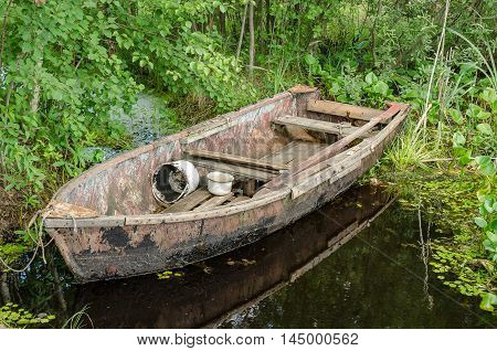 Wooden boat on the dock by the lake