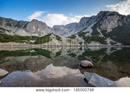 Landscape with Dark Clouds over Sinanitsa Peak and reflectionin the lake, Pirin Mountain, Bulgaria