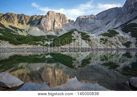 Panorama around Sinanitsa peak and  reflectionin the lake, Pirin Mountain, Bulgaria