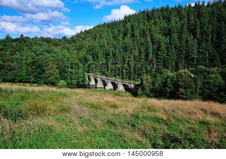 Old dissused railway bridge over the river Tweed in Peebleshire,Scotland.