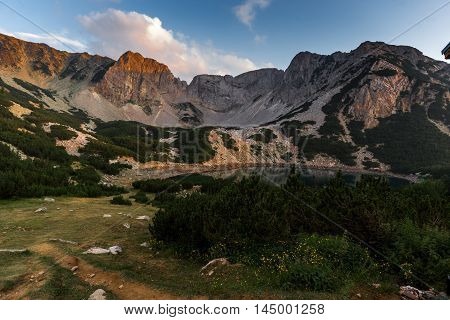 Sunset with Colored in red rock near Sinanitsa peak and  the lake, Pirin Mountain, Bulgaria