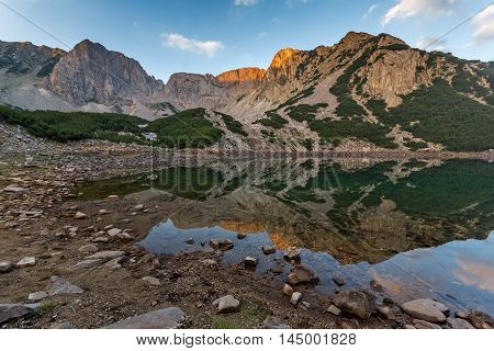 Amazing Sunrise with Colored in red rock of Sinanitsa peak and  the lake, Pirin Mountain, Bulgaria