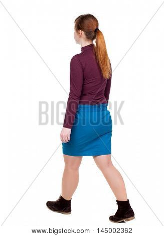 back view of walking woman. beautiful blonde girl in motion. Rear view people collection. Isolated over white background. The red-haired girl in a blue skirt goes sideways.
