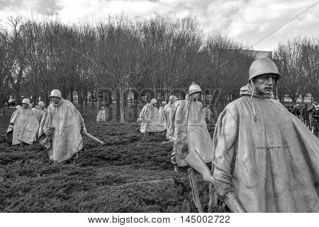WASHINGTON, DC - DEC 19: Korean War Veterans Memorial in Washington, DC, as seen on December 19, 2015. The memorial consists of 19 stainless steel statues. This is a black & white version of the shot.