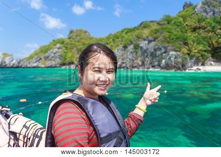 Beautiful Thai woman on the boat at Langka Jew Island It is located in the Gulf of Thai Chumphon Province Thailand