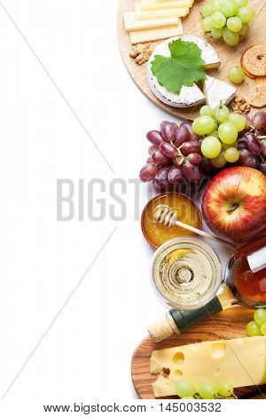 White wine, grape, cheese, bread and honey. Isolated on white background. Top view with copy space