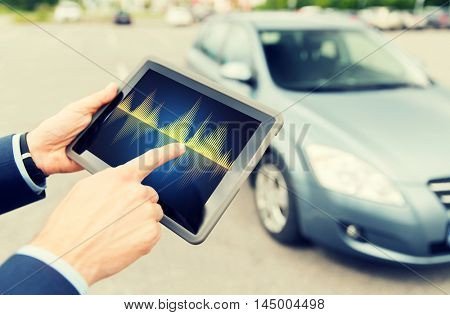 transport, business trip, technology and people concept - close up of male hands with diagram tablet pc computer screen and car outdoors