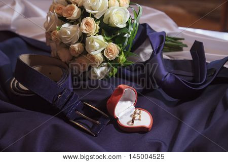 Wedding Rings Lying On The Tie And Belt