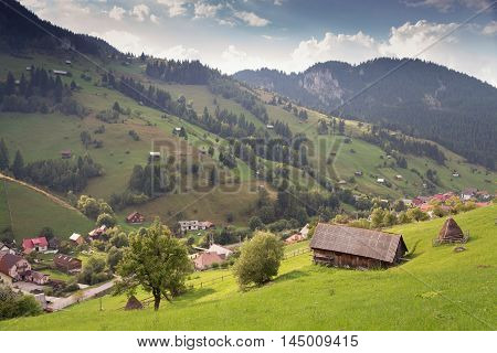 Summer landscape above the village in Moeciu de Sus - Bran, Romania