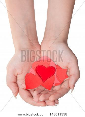 Glass Heart Above Pile Of Hearts On Female Palms