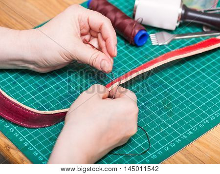 Skinner Sews New Leather Belt