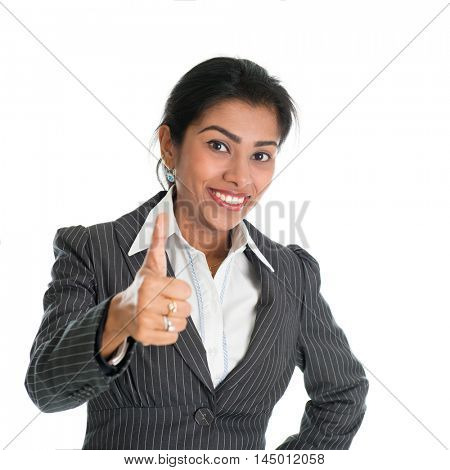 Black woman in formalwear giving a thumb up, isolated on white background.