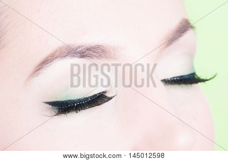 Close-up Of  Eyes Posing With Professional Trendy Make-up