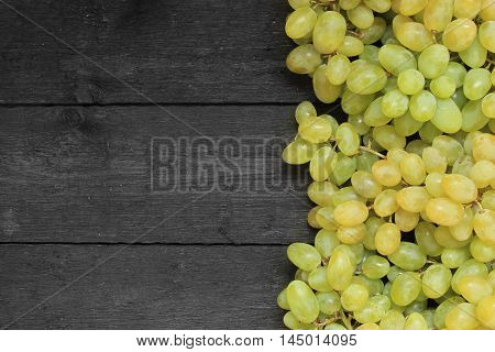 Close up view of ripe green wine grape. View with fresh green grape. Ripe grapes background. . Free place for text.Top view
