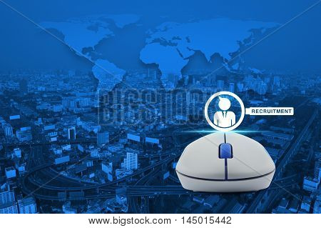 Wireless computer mouse with businessman and magnifying glass icon over city tower street and expressway Recruitment concept Elements of this image furnished by NASA