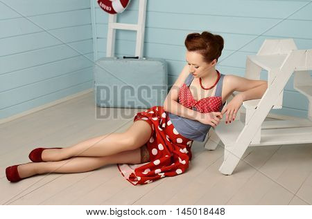 Young beatiful girl dressed at pin-up style
