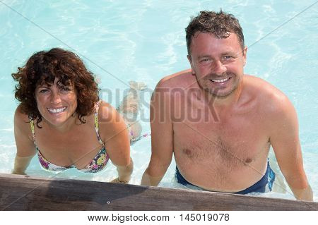 Couple, A Man And Woman - Doing Sports And Water Aerobics