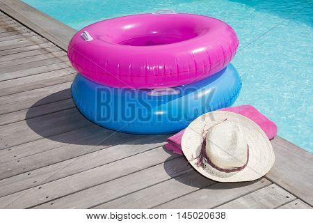 Pool Ring And Swimming Pool On Wooden Deck Summertime
