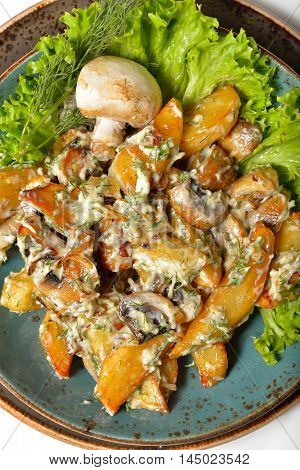 fried potatoes with mushrooms and cheese sauce